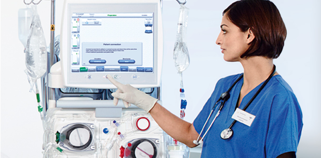 Nurse in front of renal replacement therapy machine