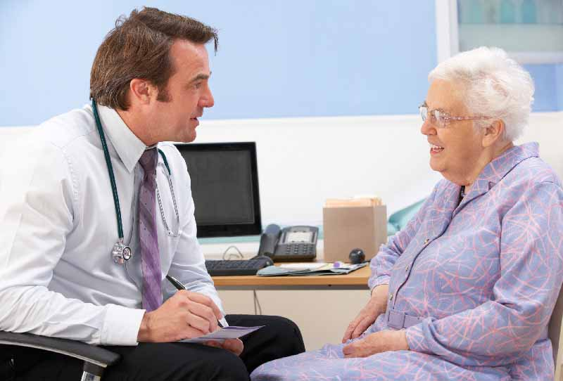 Doctor advising older patient